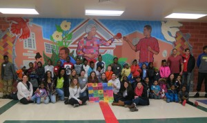 CHA children and Widener students show off their Peace Patchwork, created on the MLK Day of Service at CHA's Booker T. Washington Community Center.