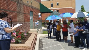 CHA's Mary Militello leads employees at memorial garden dedication.