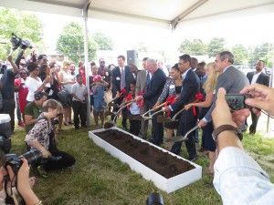 CHA executive director at groundbreaking ceremony joining Mayor Thaddeus Kirkland and others to dig in.